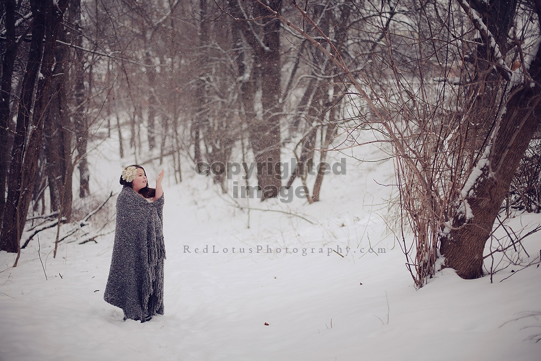 portrait of girl in snow in the woods