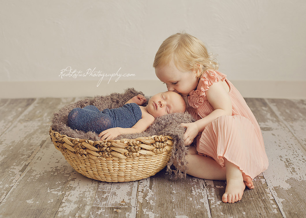 newborn siblings posing